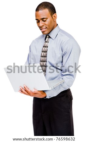 Confident businessman using a laptop and posing isolated over white - stock photo