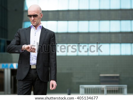 Confident businessman waiting for meeting. - stock photo