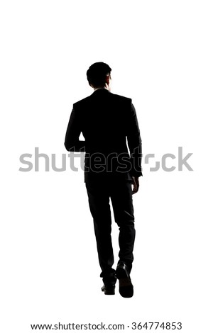 Confident businessman walking, silhouette portrait isolated - stock photo