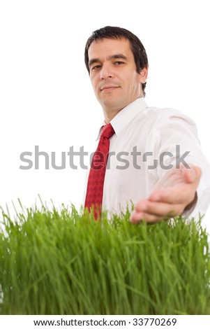 Confident businessman with grass - green environmental business concept, isolated - stock photo