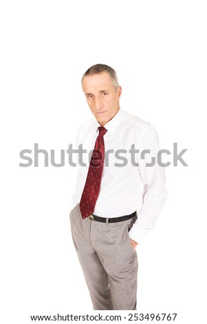 Confident businessman with hands in pockets. - stock photo