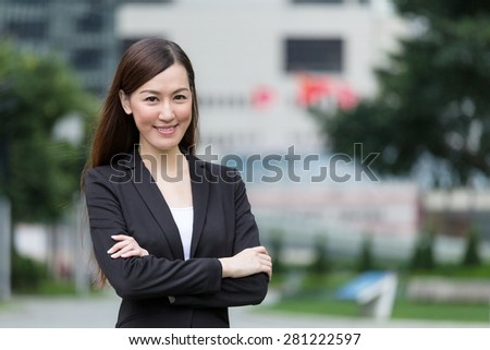 Confident Businesswoman armed crossed - stock photo