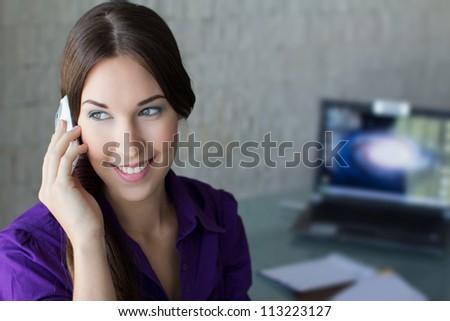Confident businesswoman calling - stock photo