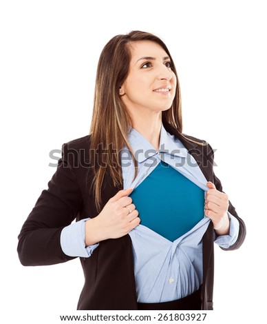 Confident businesswoman opening her shirt in superhero style isolated on white background - stock photo