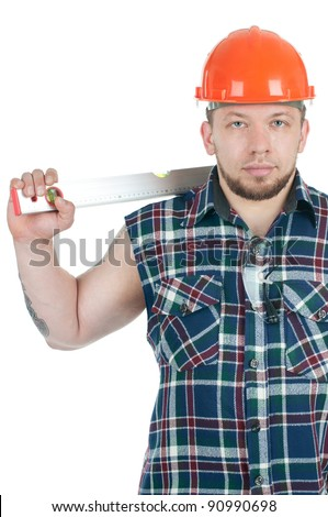 Confident caucasian building contractor in work shirt and hardhat holding a level, isolated over white - stock photo