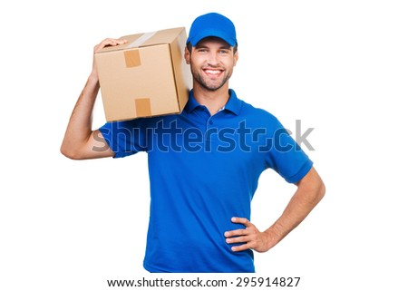 Confident delivery man. Joyful young courier carrying cardboard box on shoulder and smiling while standing against white background - stock photo