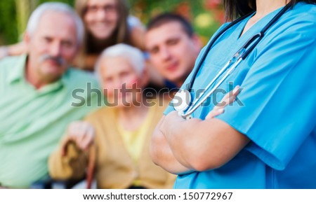 Confident doctor welcoming patients, happy family members - family medical care concept. - stock photo
