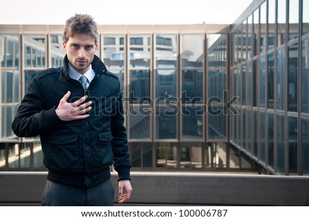 Confident elegant man portrait with building background. - stock photo
