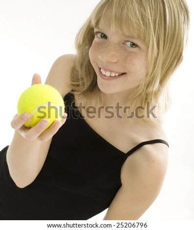 Confident Elementary Age Girl with Tennis Ball. - stock photo