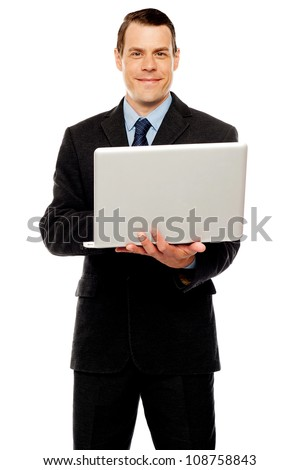 Confident executive using laptop and surfing web isolated on white background - stock photo