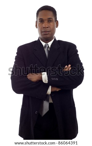 Confident good looking African American business man standing with hands folded isolated white background - stock photo