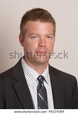 Confident handsome businessman in suit headshot portrait - stock photo