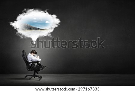 Confident handsome businessman sitting in chair and dreaming - stock photo
