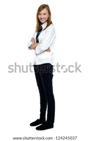 Confident high school girl posing with folded arms. Full length studio shot. - stock photo
