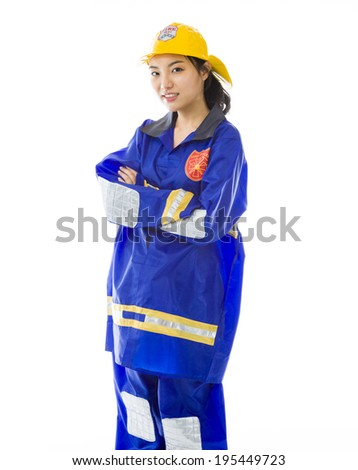 Confident lady firefighter standing with arms crossed - stock photo