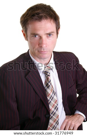 confident looking business man leaning in with jacket open - stock photo