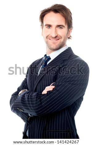 Confident male business executive, arms crossed - stock photo