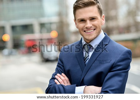 Confident male business executive, arms crossed. - stock photo