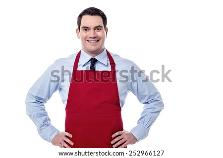 Confident male chef with hands on his waist - stock photo