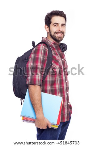 Confident male student standing with backpack and notebooks on white background - stock photo
