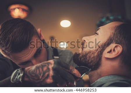 Confident man visiting hairstylist in barber shop. - stock photo