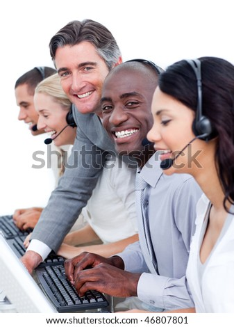 Confident manager checking his team's work in a call center - stock photo