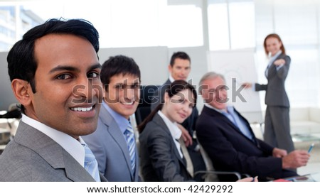 Confident manager discussing a new strategy her team in the office - stock photo