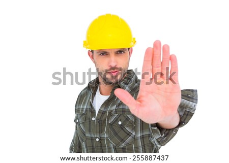 Confident manual worker gesturing stop sign on white background - stock photo
