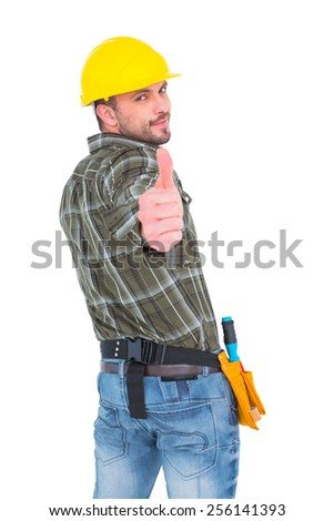 Confident manual worker gesturing thumbs up on white background - stock photo
