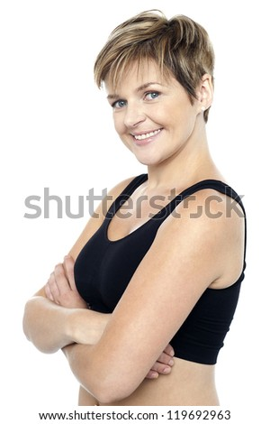 Confident middle-aged female instructor. Isolated on white - stock photo