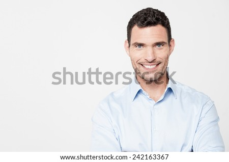 Confident middle aged man with warm smile - stock photo