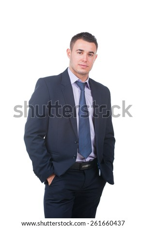 Confident modern businessman keeping his hands in trousers pockets isolated on white - stock photo