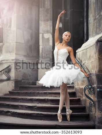 Confident moves. Vertical soft focus portrait of a graceful ballerina outdoors - stock photo