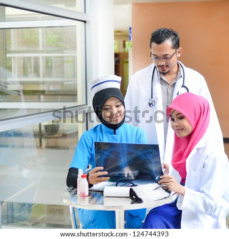 Confident Muslim doctor busy conversation at hospital - stock photo