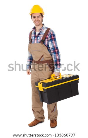 Confident repairman wearing hard hat and holding toolbox. Isolated on white - stock photo