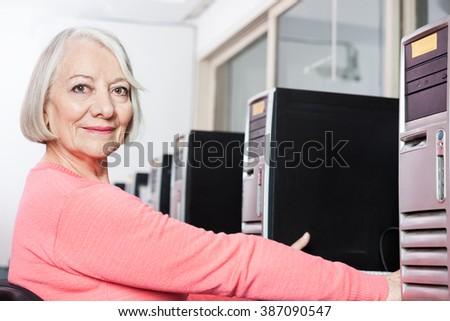 Confident Senior Woman In Computer Class - stock photo