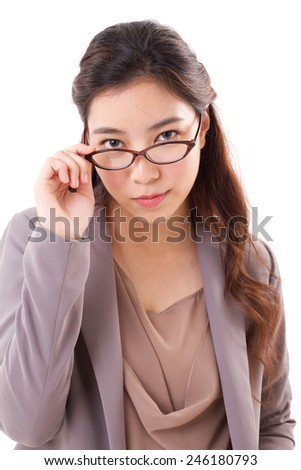 confident, serious business woman looking at you - stock photo