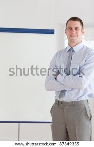 Confident smiling businessman giving a presentation - stock photo