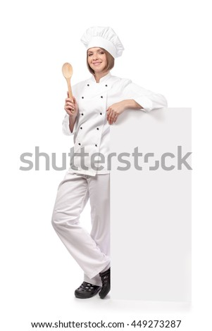 confident smiling female chef, cook or baker holding spoon and standing next to the banner with empty copy space for you text isolated on white background. advertisement blank board. your text here - stock photo