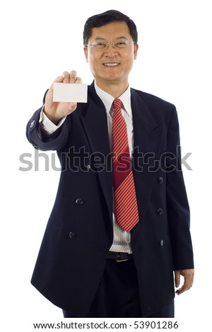 Confident smiling senior Asian business man holding a blank business card, the focus was on the business card. - stock photo