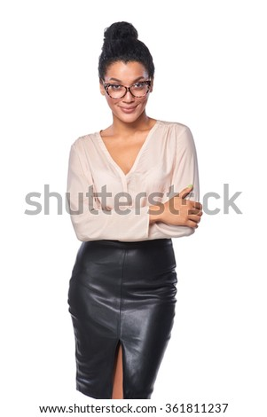 Confident successful mixed race caucasian - african american business woman in glasses, standing with folded hands and smiling at camera, isolated on white background - stock photo