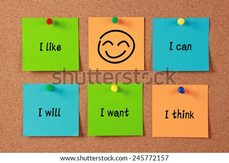 Confident Thinking sticky notes pinned on cork. - stock photo
