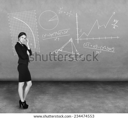 Confident thoughtful businesswoman looking at the camera - stock photo