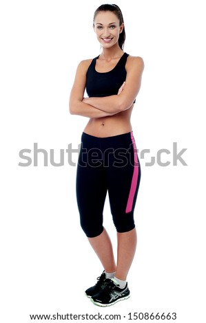 Confident trainer posing in complete gym wear - stock photo