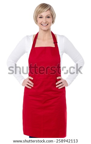 Confident woman chef with hands on her waist - stock photo