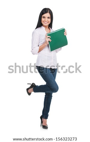 Confident woman. Full length of cheerful young woman holding note pad in her hands and smiling while standing isolated on white - stock photo