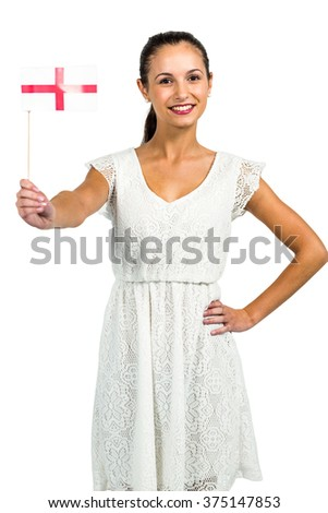 Confident woman showing England flag to the camera on white screen - stock photo