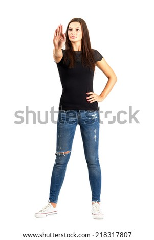 Confident woman stop hand gesture. Full body length isolated over white background. - stock photo