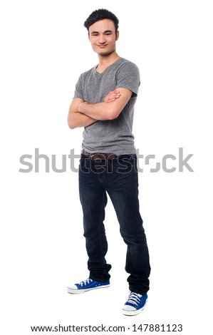 Confident young asian guy, arms crossed - stock photo