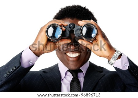 confident young black businessman looking through his binoculars at what the future business vision is - stock photo